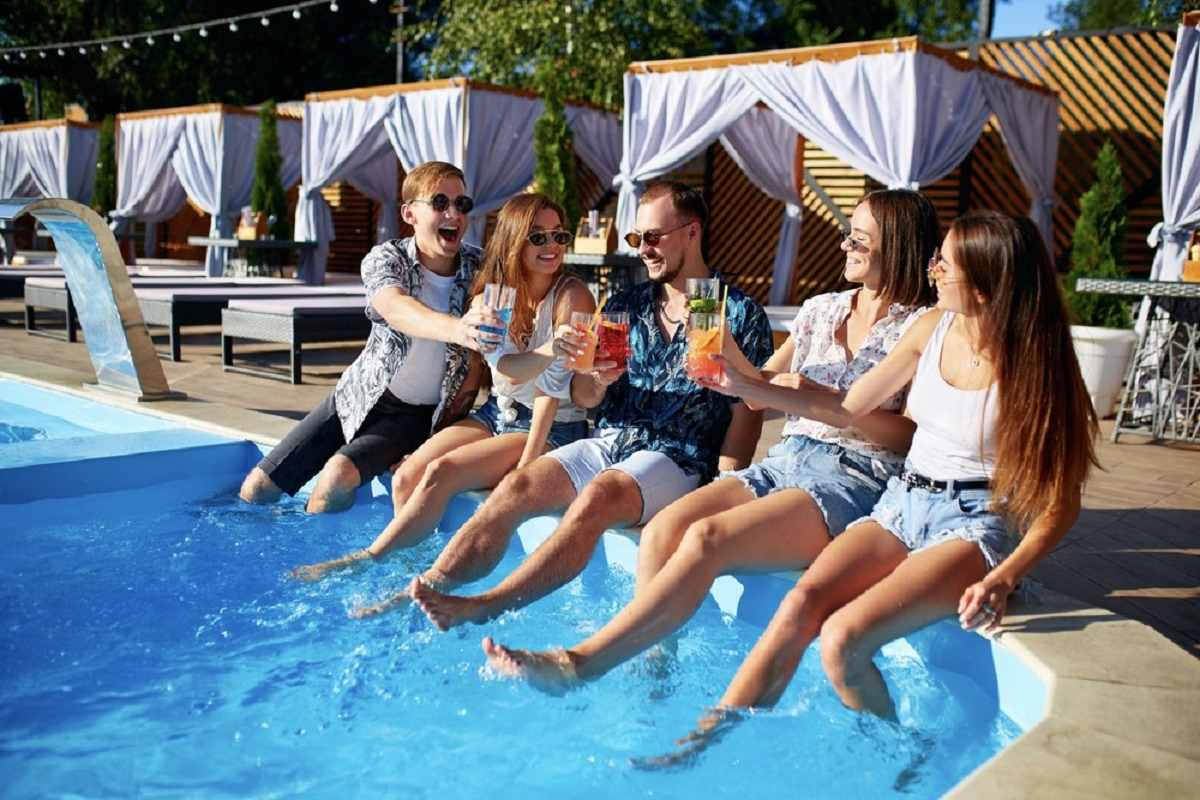 People Sitting In A Pool